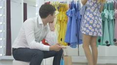 The young man wait the girl during the shopping Stock Footage