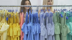 Girls look out from show stand with clothes Stock Footage