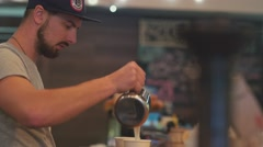 Barista makes a cup of coffee for the visitor. Coffee to go Stock Footage