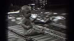 1938: a baby trying to crawl on the porch in the back yard NEW JERSEY Stock Footage