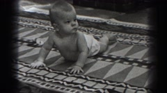 1938: cute toddle topless lying down staring at camera NEW JERSEY Stock Footage