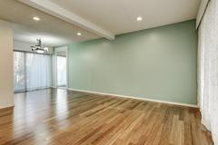 Green and mint interior of empty room with large floor to ceiling windows and Stock Photos