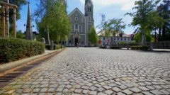 Granite sets in front of a big church Stock Footage