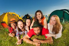 Funny young people enjoying with camping trip Stock Photos