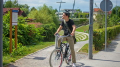 A man on a bicycle turns around and goes to the opposite direction Stock Footage