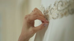 Woman touches crystals embroidered on wedding dress Stock Footage