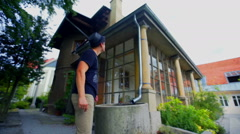 Visitor is walking around the architect Plecnik's house Stock Footage