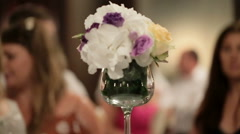 White, cream and violet roses put in the vase on dinner table Stock Footage
