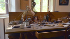 Lots of items and tools are displayed on the table Stock Footage