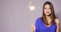 Beautiful woman holding a burning sparkler Stock Footage