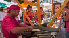 Making tortillas at Open Kitchen food market Stock Footage