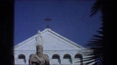 1976: pillar and statue of a saint and of mary at a catholic monastery. Stock Footage