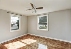 Sunny unfurnished room with hardwood floor in old empty house. Northwest, USA Stock Photos
