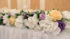 Flower garland made of artificial flowers and greenery Stock Footage