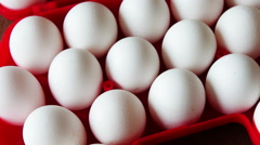 Fresh raw eggs in a red tray Stock Footage