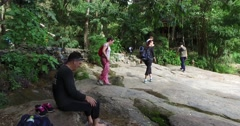 4k - hikers resting at exotic jungle temple in the mountain Stock Footage