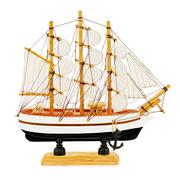 Old sailboat model isolated on white background. Closeup. Stock Photos