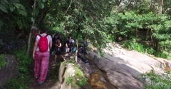 4k - diverse hiking group arriving at temple meeting point Stock Footage