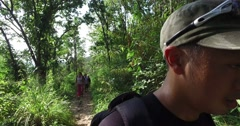 4k - selfie view of asian male leading hike group Stock Footage