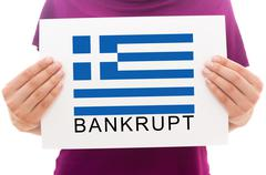 Girl holding white paper sheet with printed Greece flag and write Bankrupt Stock Photos