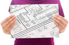 Girl holding white paper sheet with Photo of Technical Drawing Stock Photos