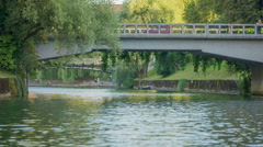 Someone is crossing the bridge over the river Ljubljanica Stock Footage