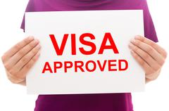 Girl holding white paper sheet with text Visa approved Stock Photos
