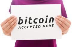 Girl holding white paper sheet with Bitcoin logo Stock Photos