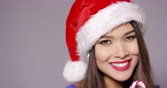 Sensuous young woman sucking on a candy cane Stock Footage