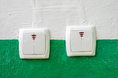 New electrical switches in the wall. Construction defect. Stock Photos