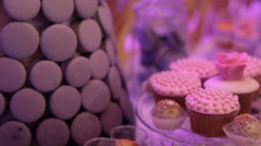 Cold desserts decorated with violet ribbons Stock Footage