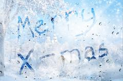 Rain on glass with Merry X-mass text Stock Photos