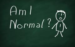On the blackboard draw character and write Am I Normal Stock Photos