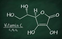 Chemical formula of Vitamin C on a blackboard Stock Photos