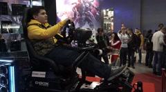 Teenager playing auto simulator Stock Footage