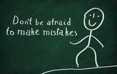 On the blackboard draw character and write Don't be afraid to make mistakes Stock Photos