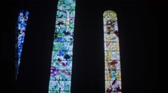 1976: large colorful stained glass windows in a darkened church ZURICH Stock Footage