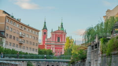 Red church in the background in downtown Ljubljana Stock Footage
