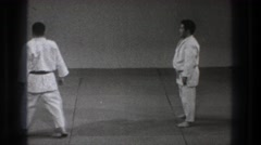 1971: two men doing martial arts TOKYO JAPAN Stock Footage