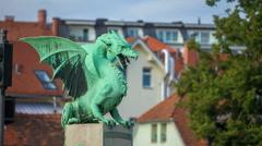 Beautiful green dragon on one of the three bridges in Ljubljana Stock Footage