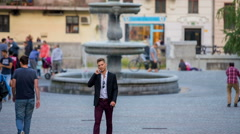 People passing a really nice fountain in the city center of Ljubljana Stock Footage