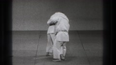 1971: two contestants demonstrating karate moves on each other. TOKYO JAPAN Stock Footage