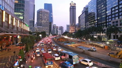 Traffic jam in Jakarta business district at sunset in Indonesia Stock Footage