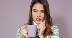 Attractive woman enjoying a hot beverage Stock Footage