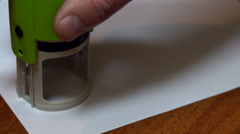 A man puts a seal on a document Stock Footage