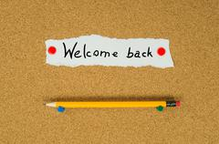 Welcome back text note message pin on bulletin board Stock Photos