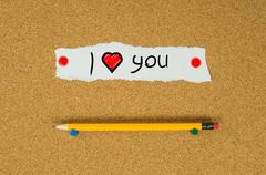 I love you text note message pin on bulletin board Stock Photos