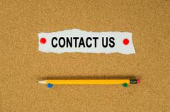 Contact us text note message pin on bulletin board Stock Photos