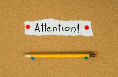 Attention text note message pin on bulletin board Stock Photos