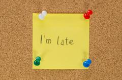I'm late note pinned on the cork board Stock Photos